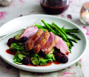 Roasted duck breast with blackberry and port sauce